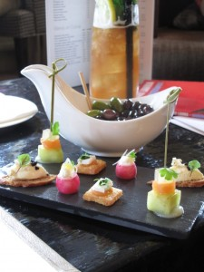 Canapes, olives and iced tea at Le Manoir