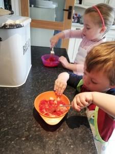 Mashing strawberries and banana